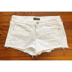 white, distressed mid-rise shorts